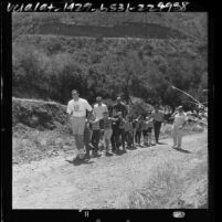 Group of blind boys being led up hill on hike at Camp Bloomfield in the Malibu Mountains, Calif., 1964