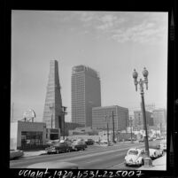 Street scene with Standard Oil Co. oil derrick stands with construction on Occidental Building in Los Angeles, Calif., 1964