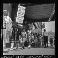 American Indians,in tribal garb, picketing in front of Bureau of Indian Affairs headquarters in Los Angeles, Calif., 1964