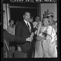 Oklahoma attorney Robert O. Swimmer being greeted by group of California Indians, 1964