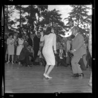 Luci Baines Johnson dancing the Watusi with actor Steve McQueen at Young Citizens for Johnson barbecue in Beverly Hills, Calif., 1964