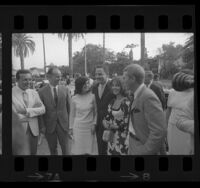 Luci Baines Johnson, Earl Warren Jr., Senator Birch Bayh, Natalie Wood and Steve McQueen arriving at party in Beverly Hills, Calif., 1964
