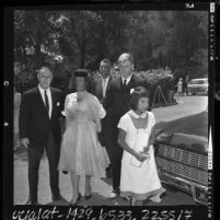 Actress Dale Evans arriving with her children Roy Jr. and Dodie to funeral for her daughter Debbie Lee, Calif., 1964