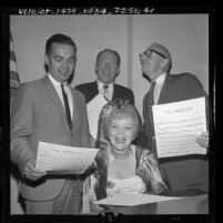 Vivian Duncan singing with Councilmen James B. Potter Jr., John P. Cassidy and Mayor Samuel W. Yorty for Los Angeles' 183rd birthday, 1964