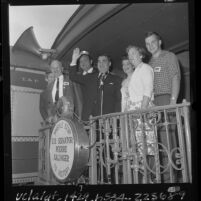Senator Pierre Salinger with family and actor Dan Blocker on his Whistle Stop campaign train in Los Angeles, Calif., 1964