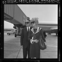 Carol Channing with husband, producer Charles F. Lowe arriving at airport in Los Angeles, Calif., 1964