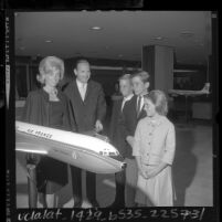 Former Senate secretary, Bobby Baker visiting airplane exhibit with his wife and three children in Los Angeles, Calif., 1964