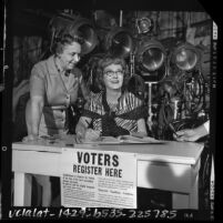Publicity shot of actress Bette Davis registering to vote at 20th Century Fox studios in Los Angeles, Calif., 1964