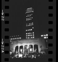 Night scene of Los Angeles City Hall decorated and lighted for Mexico's independence day celebration, 1964