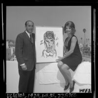 Author Henry Miller and actress Ziva Rodan with portrait of herself painted by Miller, 1964