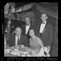Secretary of State Dean Rusk, Councilwoman Rosalind Wyman sitting at a reception with Justice Stanley Mosk, and Atty. Gen. Thomas Lynch, 1964