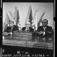 Christopher Taylor, Augustus F. Hawkins and Dr. H. Hartford Brookins holding a press conference in Los Angeles, Calif., 1964