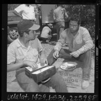 Mexican bracero and Mexican American agricultural laborers eating lunch in Ventura County, Calif., 1964