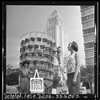 Three city employees with display of trash cans during Los Angeles, Calif. National Public Works Week in 1964