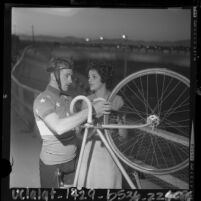 Cyclist Mike Hiltner talking with his wife Neide during training for 1964 Olympics in Santa Monica, Calif.
