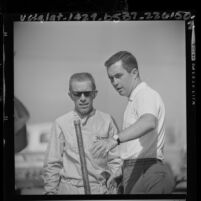 Race car drivers Roger Penske and Richie Ginther at 1964 Los Angeles Times Grand Prix trials