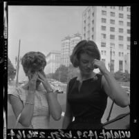 Two women on smoggy day in downtown Los Angeles, Calif., 1964