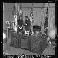 Peter and Pat Lawford at John F. Kennedy exhibit at California Museum of Science and Industry, 1964