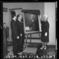 Albert A. LeVine, Samuel W. Yorty and Elizabeth Bannerman unveiling portrait of Rufus B. von KleinSmid, 1964
