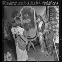 Three children modeling Halloween costumes made for Pasadena Assistance League's Craft Fair, Calif.,  1964