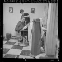 Businessman Sol Biharie getting his hair styled by Darrell Wilde in Los Angeles, Calif., 1964