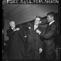 William R. Ely, Judge W. R. Ely, helping Walter Ely put on his judicial robes in Los Angeles, Calif., 1964