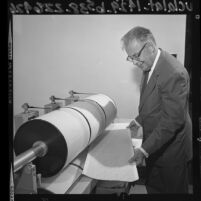 Dr. Charles Richter analyzing a seismograph log in Los Angeles, Calif., 1964