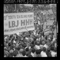 Crowd of people carrying banners during political rally for Lyndon B. Johnson in Los Angeles, Calif., 1964