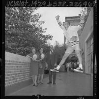 University of California, Berkeley yell leader, Jamie Sutton performing cheer at Alumni luncheon, 1964