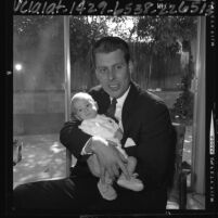 U.S. Congressman-elect John V. Tunney holding his 3 month old son, 1964