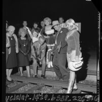 Las Vegas Mayor Oran K. Gragson pounding in silver spike at Los Angeles Union Station on 100th anniversary of Nevada's statehood, 1964