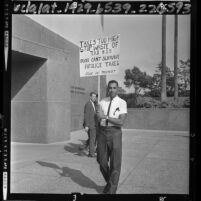 Washington Davis, real estate broker, picketing Los Angeles Hall of Administration in protest against property taxes, 1964