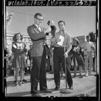 Olympic athlete and math teacher Mike Larrabee receiving award from students at Monroe High School in Los Angeles, Calif., 1964