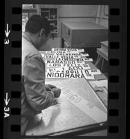 John C. Tarin, street sign painter laying out letters for Spanish named streets in Glendale, 1964