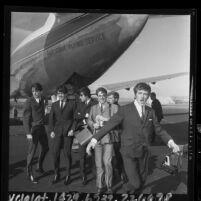 Dave Clark Five band members disembarking plane at Los Angeles International Airport, 1964