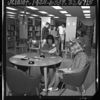 Group of Boy and Girl Scouts reading in Space Technology Laboratories' library in Redondo Beach, Calif., 1964
