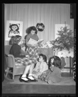 Barbara Dalo reading the Christmas story in combined Christmas and Chanukah program at Evergreen Avenue School in Los Angeles, Calif., 1948