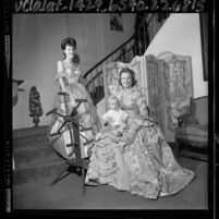 Two members of the Los Angeles, Calif. chapter of Daughters of the American Revolution in 18th-century dresses, 1964