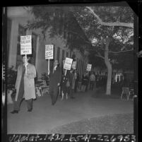 """Teachers with placards reading """"collective bargaining"""" marching outside Los Angeles Board of Education, 1964"""