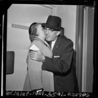 Los Angeles Police Chief William H. Parker getting a kiss from his wife Helen, 1964