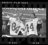 George H. W. Bush and Ronald Reagan with football jerseys presented to them at GOP convention in Dallas, Tex., 1984