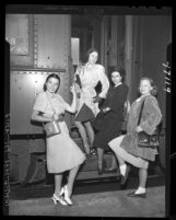 Members of Ballet Russe de Monte Carlo posing as they arrive at train station in Los Angeles, Calif., 1947