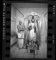 Priest with statue of Hindu god Shiva at Hindu Temple near Malibu, Calif., 1984