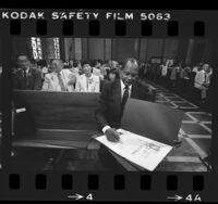 Los Angeles Mayor Tom Bradley signing proclamations for Japanese American World War II internees, 1984