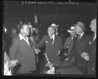 Congressman and labor union leaders in heated argument during Congressional committee inquiry into film strikes, Los Angeles, Calif., 1947