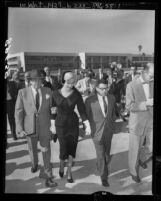 Actress Marilyn Monroe walking from Santa Monica courthouse with her attorney, Jerry Giesler after divorce from Joe DiMaggio, 1954