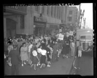 Lady garment worker's picket line disrupting pedestrian traffic at 850 S. Broadway in Los Angeles, Calif., 1947
