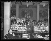 Placard-bearing citizens protesting Harbor Freeway project at Los Angeles County Board of Supervisors meeting in 1947