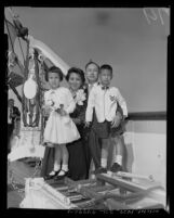 California Institute of Technology scientist, Dr. Hsue-shen Tsien with his family onboard SS President Cleveland, Los Angeles, 1955