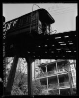 Close up of Angels Flight train passing by buildings in 1955